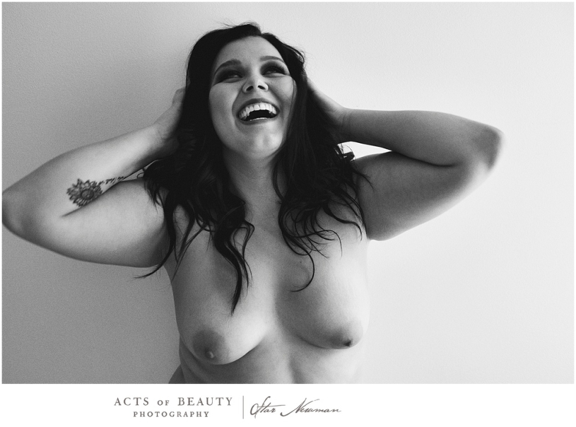 Laughing nude woman empowerment photo