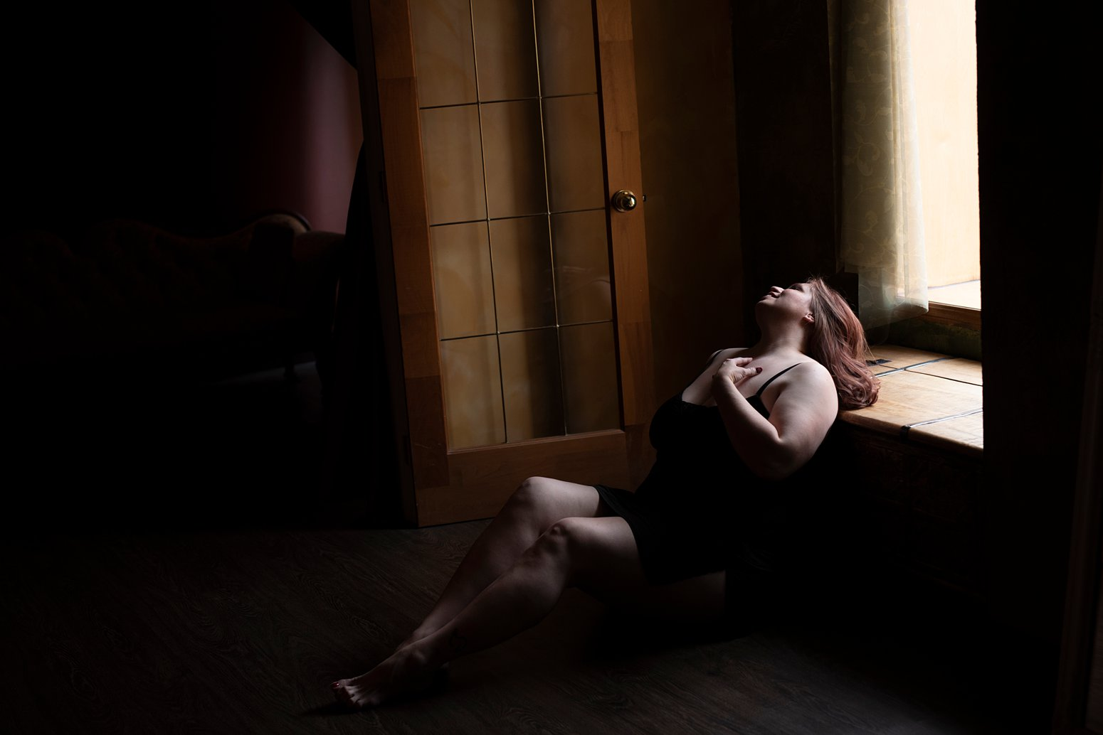 Beautiful moody natural light boudoir photo