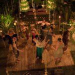 Women dancing with Balinese dancers at women's empowerment retreat