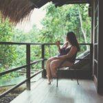 Woman drinking coffee on a balcony in Bali