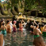 Women praying at water temple in Bali