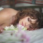 Serene boudoir photo of nude woman in Bali with flowers